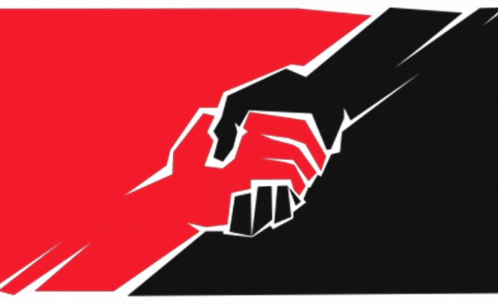 Image shows two hands across a red and black flag