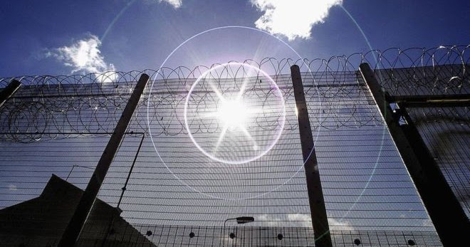 Image shows a prison fence
