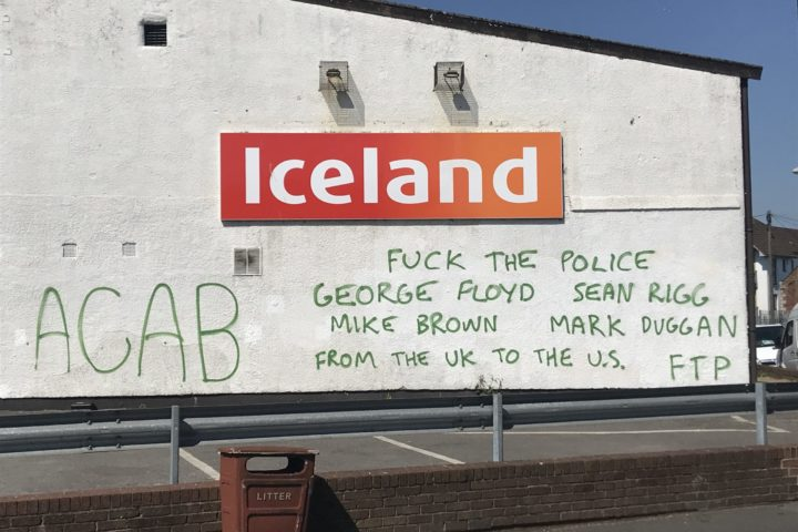 Image shows description of ACAB graffiti on a supermarket wall