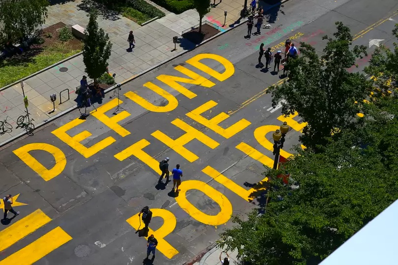 Defund the police painted on the street