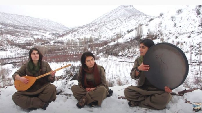 Guerillas playing traditional instruments in the mountains