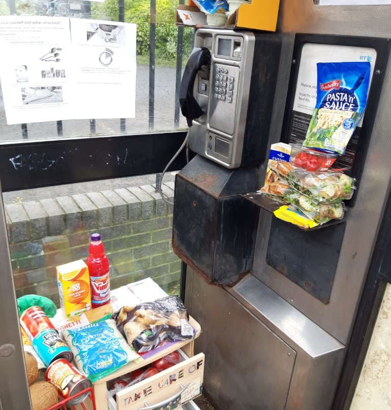 Free food being given away in a phone box