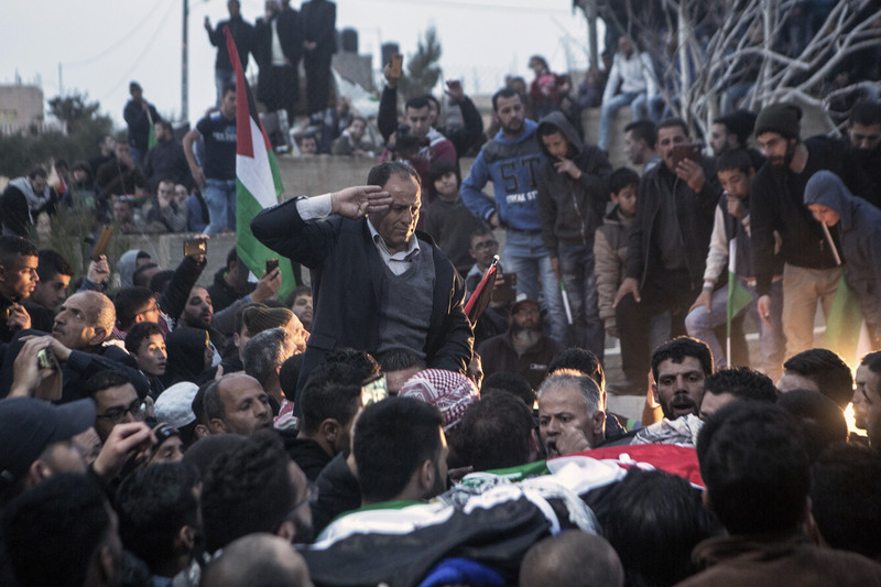 Mahmoud al-Araj, the father of Bassel al-Araj, salutes his son's body during his funeral in al-Walaja, his home village in the occupied West Bank, on 17 March 2017. Anne Paq ActiveStills