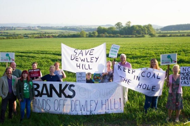Image shows a group protest against Banks Group