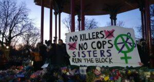 "Image shows a banner saying 'No Killers, No cops. Sisters run the block"""