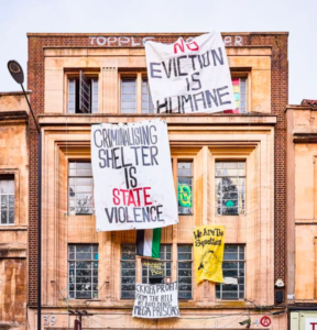 Photo of squatted building with banners hanging on the walls